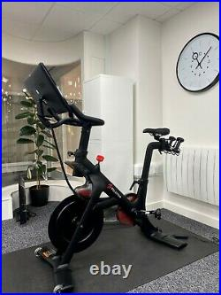 Peleton bike with weights and mat